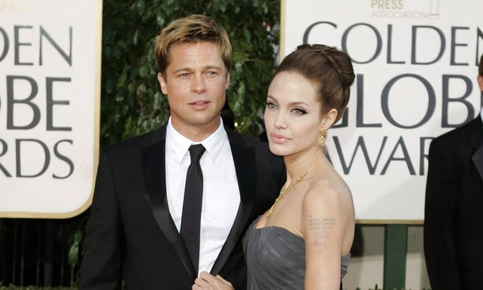 A file photo shows Brad Pitt, and Angelina Jolie   (AP Photo/Mark J. Terrill, File)