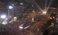 Tens of Thousands Call on South Korea's President to Quit