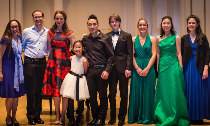"NY Concerti Sinfonietta features seven Shining Stars and one rainbow.  (L–R) Julie Jordan, artistic director/founder of New York Concerti Sinfonietta; John Bell, pianist who accompanied ""Finian's Rainbow"" star; singer and star Melissa Errico; violinist Lauren Yoon; violinist David Marks; pianist  Eoín Fleming; violinist Claire Austen; violist Annie Xue Ding, and cellist Aoife Burke,  onstage at Carnegie Hall. (James Hall)"
