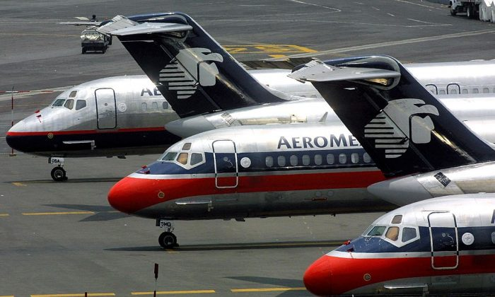 Aeromexico jetliners stand idle on the tarmac in Mexico City. An Aeromexico plane crashed in Durango on July 31. (Ramon Cavallo/AFP/Getty Images)
