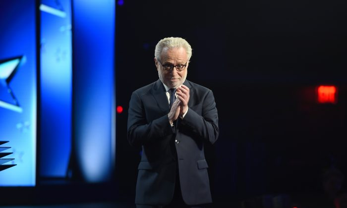 TV Personality Wolf Blitzer appears on stage during Turner Upfront 2016 show at The Theater at Madison Square Garden in New York City on May 18, 2016. Emails leaked by WikiLeaks reveal the DNC colluding with CNN and Blitzer on question to ask Donald Trump. (Nicholas Hunt/Getty Images for Turner)
