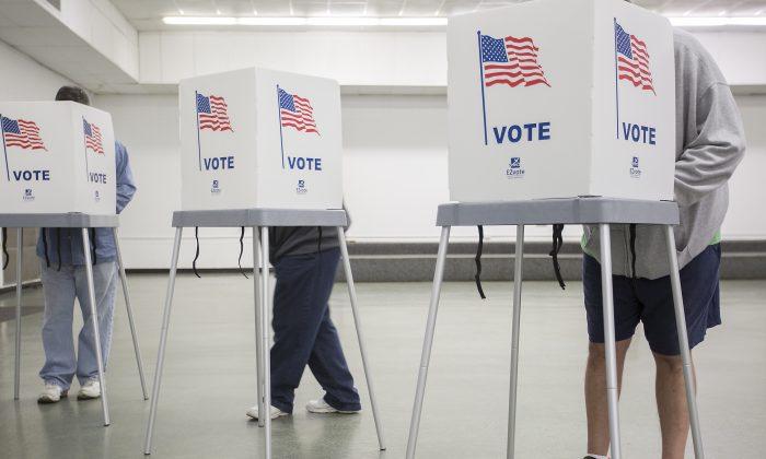 McCracken County residents vote at the Robert Cherry Civic Center in Paducah, Ky., on Nov. 8, 2016. (Ryan Hermens/The Paducah Sun via AP)