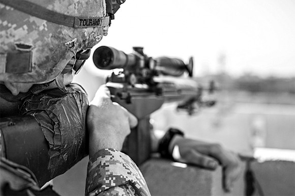 Sgt. Joe Tourand scans the Daura neighborhood of southern Baghdad during the troop surge of 2007. (Courtesy of Emmet Cullen)
