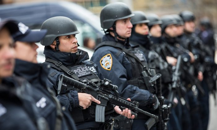 Members of the New York Police Department (NYPD) Strategic Response Group stand outside NYPD headquarters in New York City, N.Y., on Feb. 17, 2016. (Andrew Burton/Getty Images)