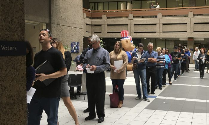 The line of voters waiting to cast an early ballot at the Santa Clara County Registrar of Voters' office winds into the building's atrium in San Jose, Calif., on Nov. 7, 2016. (Ramman Kenoun/Santa Clara Country Registrar of Voters via AP)
