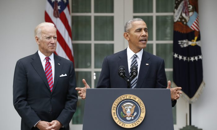 President Barack Obama, accompanied by Vice President Joe Biden, speaks in the election in the Rose Garden of the White House in Washington, on Nov. 9, 2016. (AP Photo/Pablo Martinez Monsivais)