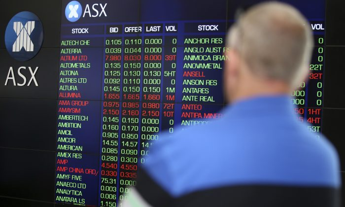 A man watches the display board at the Australian Stock Exchange in Sydney, Australia on Nov. 10, 2016. (Rick Rycroft/AP)