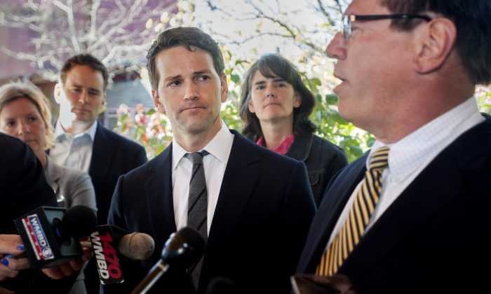 Former U.S. Rep. Aaron Schock (C) and members of his family listen as attorney Jeff Lang (R) speaks during a press conference outside Peoria Heights Village Hall in Peoria Heights, Ill. on Nov. 10, 2016. Schock''s defense team said Thursday that the former congressman, who resigned amid scrutiny of lavish spending, expects to be indicted by a federal grand jury. (Matt Dayhoff/Journal Star via AP)