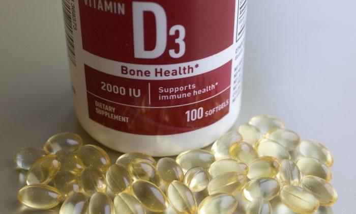 A container of Vitamin D capsules. (AP Photo/Mark Lennihan)