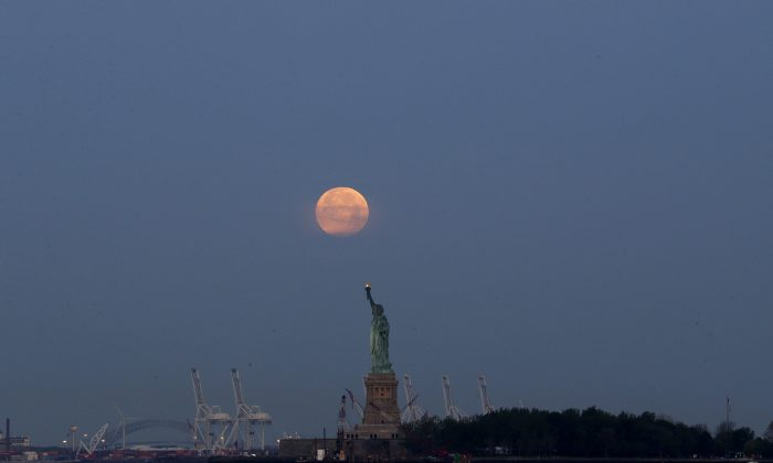 A supermoon over the Statue of Liberty in New York. (AP Photo/Julio Cortez)