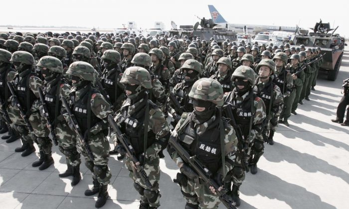Troops from the People's Armed Police form up for an anti-hijack drill in Guangzhou City, China on Nov. 16, 2005. (China Photo/Getty Images)