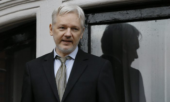 WikiLeaks founder Julian Assange speaks from the balcony of the Ecuadorean Embassy in London, in this file photo. (Kirsty Wigglesworth/AP)