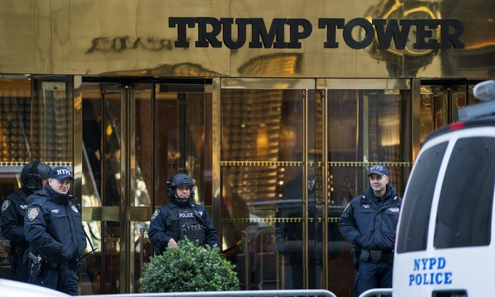 New York City police stand guard in front of Trump Tower, a residence of President-elect Donald Trump in New York, on Nov. 13, 2016. (AP Photo/Craig Ruttle)