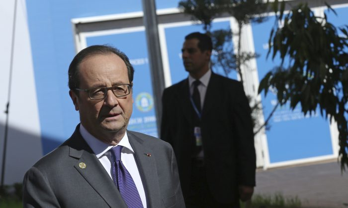 """France's President Francois Hollande at the opening session of the U.N. climate conference in Marrakech, Morocco on Nov. 15, 2016. United Nations Secretary-General Ban Ki-moon says he hopes Donald Trump will shift course on global warming and """"understand the seriousness and urgency"""" of addressing the problem. (AP Photo/Mosa'ab Elshamy)"""