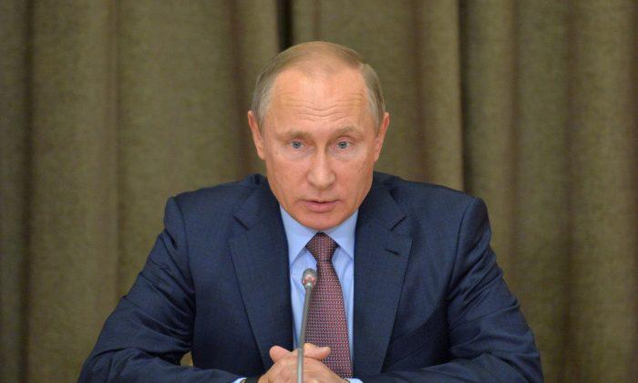 Russian President Vladimir Putin heads a meeting on military industry issues in the Black Sea resort of Sochi, Russia, on Nov. 15, 2016. (Alexei Druzhinin/Sputnik, Kremlin Pool Photo via AP)