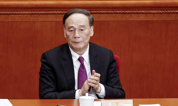 Wang Qishan, head of the Chinese regime's anti-corruption agency, attends the Chinese People's Political Consultative Conference on March 3, 2016. (Lintao Zhang/Getty Images)