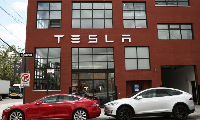 Tesla vehicles sit parked outside of a new Tesla showroom and service center in Red Hook, Brooklyn on July 5, 2016 in New York City. The electric car company and its CEO and founder Elon Musk have come under increasing scrutiny following a crash of one of its electric cars while using the controversial autopilot service. Joshua Brown crashed and died in Florida on May 7 in a Tesla car that was operating on autopilot, which means that Brown's hands were not on the steering wheel. (Spencer Platt/Getty Images)