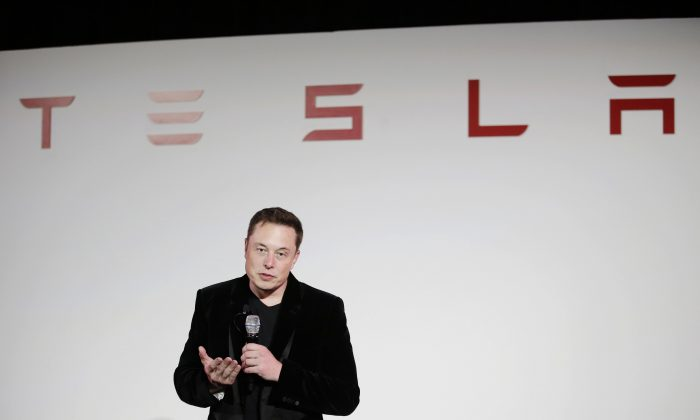 Elon Musk, CEO of Tesla Motors Inc., talks about the Model X car at the company's headquarters, in Fremont, CA., in this file photo. (AP Photo/Marcio Jose Sanchez, File)