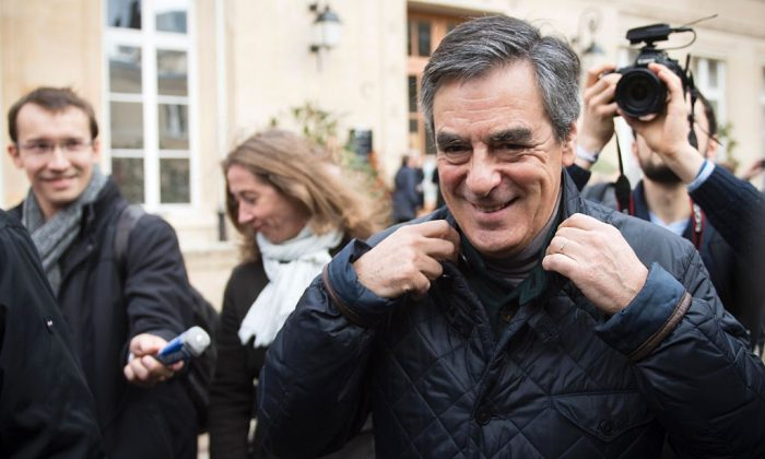 Candidate for the conservative Les Republicains (LR) party primaries ahead of the 2017 presidential election and former French prime minister Francois Fillon (R) leaves after voting at a polling station, in Paris on Nov. 20, 2016 (MARTIN BUREAU/AFP/Getty Images)