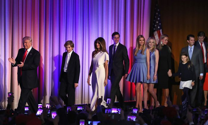 Republican president-elect Donald Trump on stage with his son (L-R) Barron Trump, wife Melania Trump, Jared Kushner, Ivanka Trump, Tiffany Trump, Vanessa Trump, Donald Trump Jr., and Eric Trump during his election night event at the New York Hilton Midtown in New York City on Nov. 9, 2016. (Photo by Mark Wilson/Getty Images)