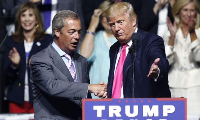 Then-Republican presidential candidate Donald Trump (R) welcomes pro-Brexit British politician Nigel Farage, to speak at a campaign rally in Jackson, Miss., in this file photo. (AP Photo/Gerald Herbert, File)