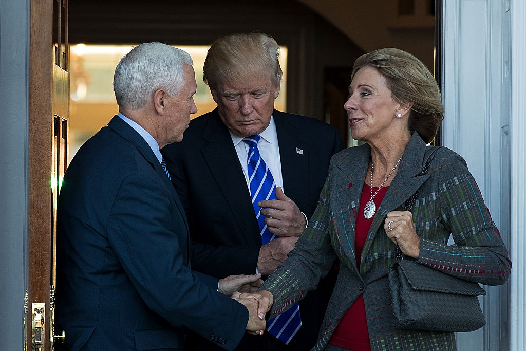 (L to R) Vice president Mike Pence, President Donald Trump and Betsy DeVos  leave the clubhouse after their meeting at Trump International Golf Club, in Bedminster Township, NJ., on Nov. 19, 2016. (Photo by Drew Angerer/Getty Images)
