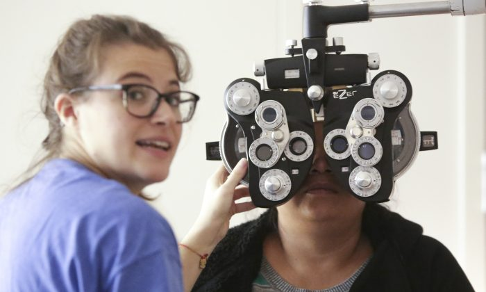 A woman gets an eye exam  (Photo credit should read Jason RE/AFP/Getty Images)