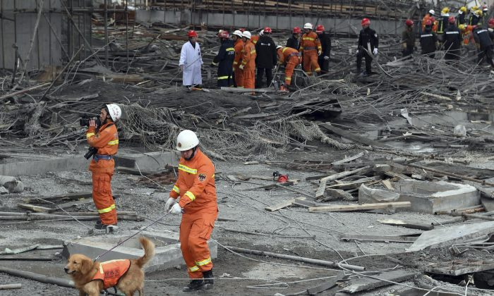Rescue workers look for survivors after a work platform collapsed at the Fengcheng power plant in eastern China's Jiangxi Province on Nov. 24, 2016. (Wan Xiang/Xinhua via AP)