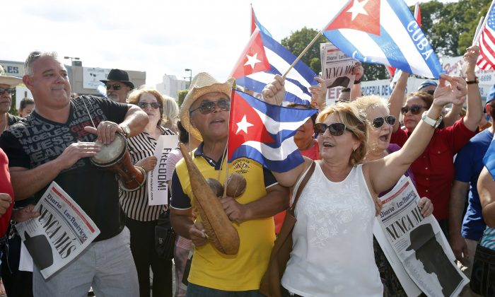 Cuban Americans celebrate the death of Cuban leader Fidel Castro on the streets in the Little Havana neighborhood of Miami Florida on Nov. 27, 2016. (RHONA WISE/AFP/Getty Images)
