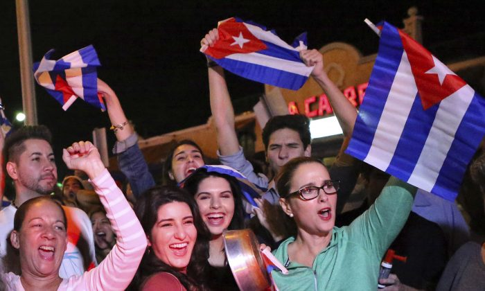 In this file photo, the Cuban community in Miami celebrates the announcement that Fidel Castro died in front La Carreta Restaurant early in Miami on Nov. 25, 2016. (David Santiago)