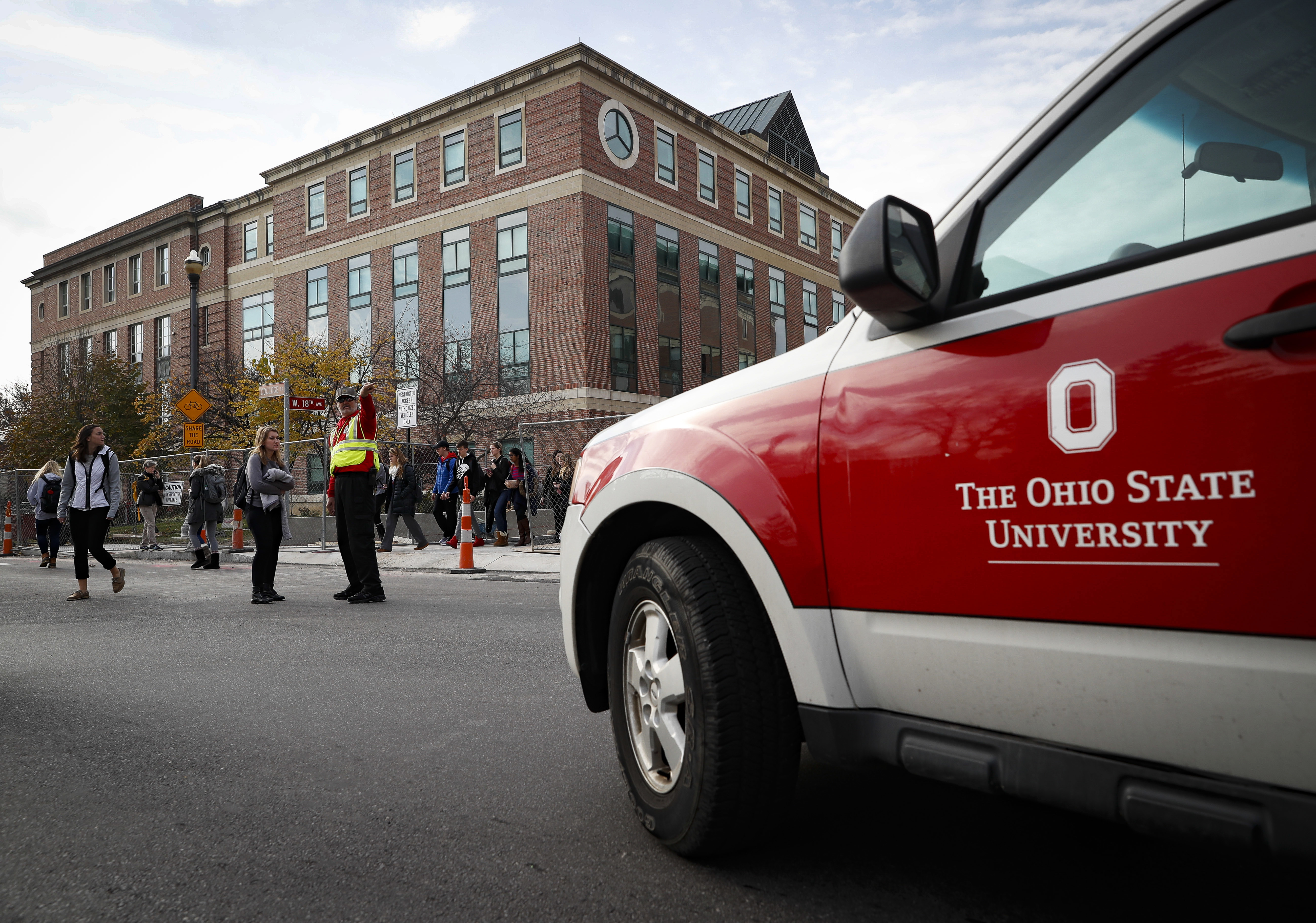 Students leave buildings as police respond to an attack on campus at Ohio State University, in Columbus, OH., on Nov. 28, 2016. (AP Photo/John Minchillo)