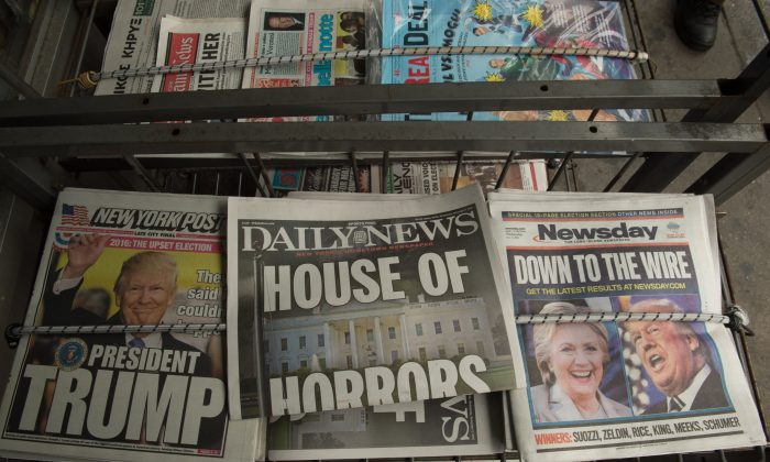 """Newspapers for sale in New York City following Donald Trump's presidential win on Nov. 9, 2016. Donald Trump has pledged to unite a nation deeply divided after the bitterest election in recent memory, vowing to be a """"president for all Americans."""" (BRYAN R. SMITH/AFP/Getty Images)"""