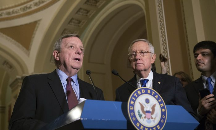 Minority Whip Richard Durbin, D-Ill., speaks to the media with Senate Minority Leader Harry Reid, D-Nev., after the Senate Policy Luncheon on Capitol Hill in Washington on Nov. 29, 2016. (AP Photo/Molly Riley)