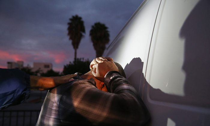 A man is detained by Immigration and Customs Enforcement (ICE), agents in Los Angeles, CA., on on October 14, 2015. (John Moore/Getty Images)