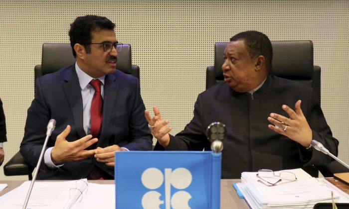 Mohammed Bin Saleh Al-Sada, Minister of Energy and Industry of Qatar and President of the OPEC Conference talks with Mohammad Sanusi Barkindo (L-R) OPEC Secretary General of Nigeria prior to the start of a meeting of the Organization of the Petroleum Exporting Countries, OPEC, at their headquarters in Vienna, Austria, on Nov. 30, 2016. (AP Photo/Ronald Zak)