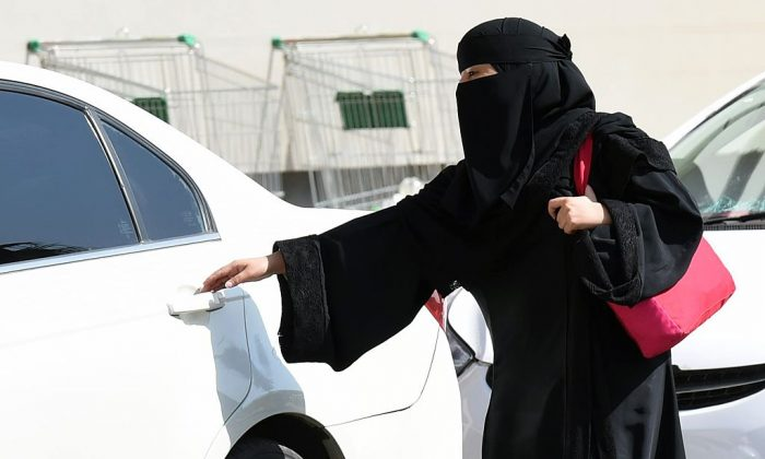 A Saudi woman gets into a taxi at a mall in Riyadh as a grassroots campaign planned to call for an end to the driving ban for women in Saudi Arabia on October 26, 2014. (FAYEZ NURELDINE/AFP/Getty Images)