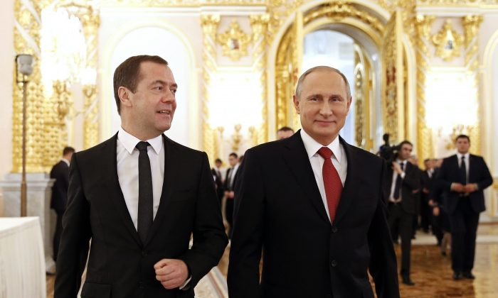 Russian Prime Minister Dmitry Medvedev (L) and President Vladimir Putin walk after the president delivered his annual state of the nation address in the Kremlin in Moscow on Dec. 1, 2016. (Dmitry Astakhov/ Sputnik, Government Press Service Pool photo via AP )