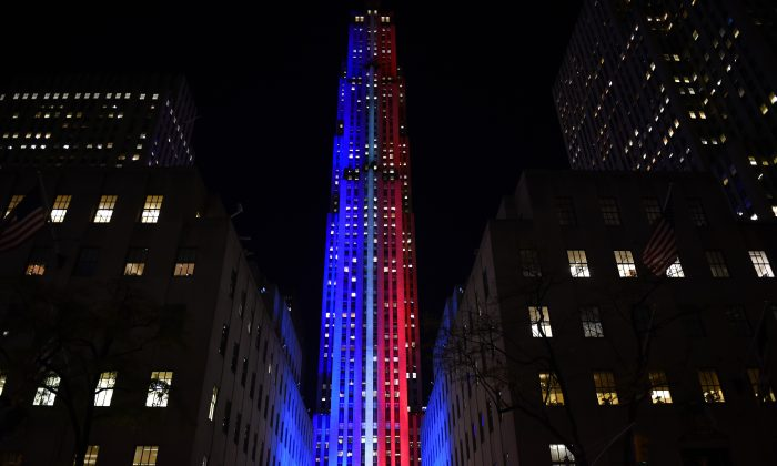 Rockefeller Center and Rockefeller Plaza is lit up in red and blue to mark the electoral progress of Hillary Clinton and Donald Trump on Nov. 7, 2016 as part of NBC's election night coverage. (TIMOTHY A. CLARY/AFP/Getty Images)