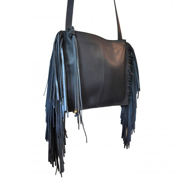 Hiwot grey leather bag with fringing. Fun, stylish, and well-made, it is a great size for every day and can be worn across the body for practicality. It is produced in Ethiopia by a woman-led small business, supporting the important leather and craft industry in Ethiopia.  £145 danaqa.com