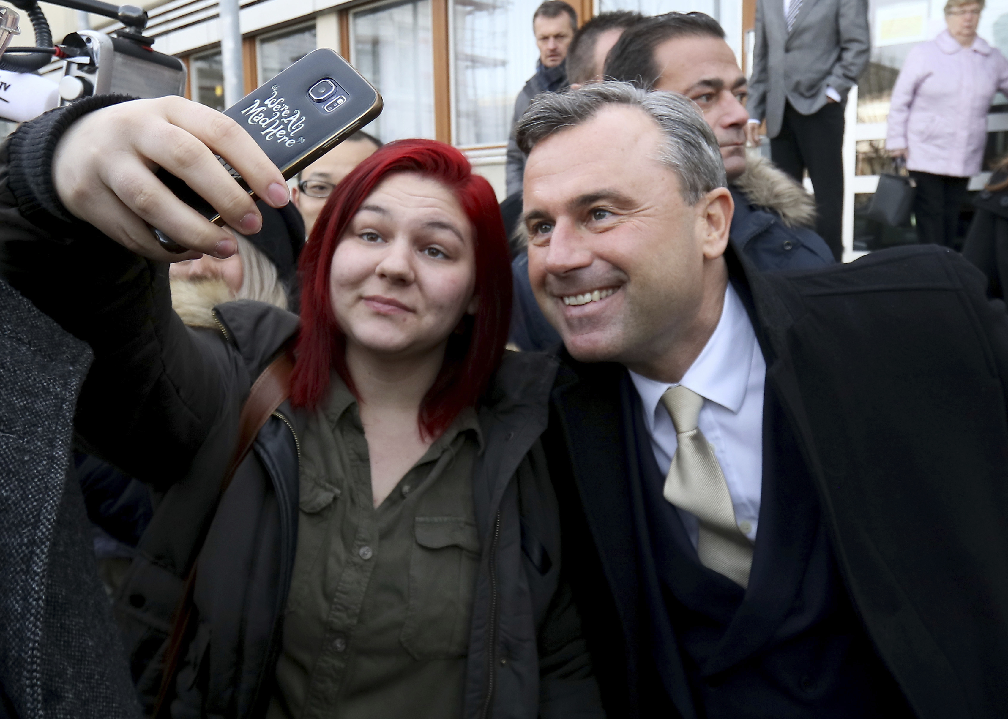 Norbert Hofer of Austria's Freedom Party, FPOE, takes pictures during the Austrian presidential elections, in Pinkafeld, Austria, on Dec. 4, 2016. (AP Photo/Ronald Zak)