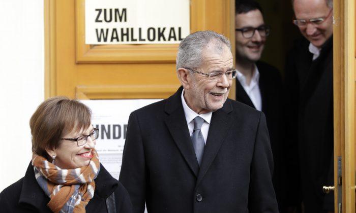 Alexander Van der Bellen, candidate of the Austrian Greens, and his wife Doris Schmidauer leave a polling station after casting their votes in Vienna, Austria on Dec. 4, 2016. (AP Photo/Matthias Schrader)