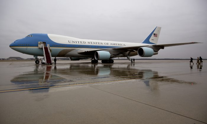 Air Force One is seen on the tarmac at Andrews Air Force Base, Md. before President Barack Obama boards en route to MacDill Air Force Base in Tampa, Fla. on Dec. 6, 2016. President-elect Donald Trump wants the government's contract for a new Air Force One canceled. (AP Photo/Carolyn Kaster)