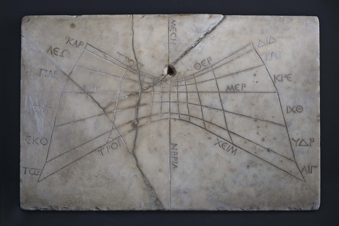 Horizontal sundial with Greek inscriptions, before 79 CE, Pompeii. Marble, H. 21 inches by W. 13 and 1/2 inches by D. 1 inch. Museo Archeologico Nazionale di Napoli. (Guido Petruccioli/Institute for the Study of the Ancient World)