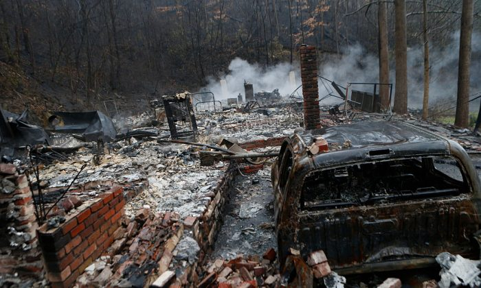 The remains of a home smolder in the wake of a wildfire in Gatlinburg, Tennessee Nov. 30, 2016. (Brian Blanco/Getty Images)