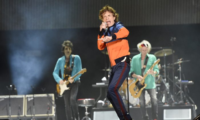 Mick Jagger (C), performs with Ron Wood (L) and Keith Richards of the Rolling Stones during their performance on day 1 of the 2016 Desert Trip music festival at Empire Polo Field in Indio, CA. (Chris Pizzello/Invision/AP)