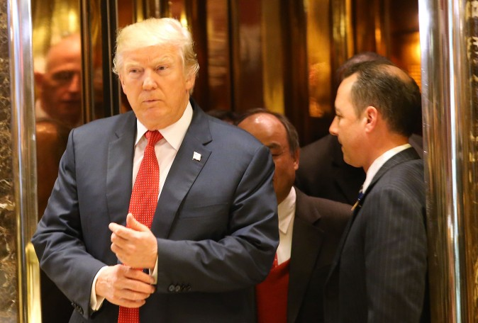 President-elect Donald Trump walks out of an elevator speak to the media at Trump Tower in New York City on Dec. 6, 2016. (Spencer Platt/Getty Images)