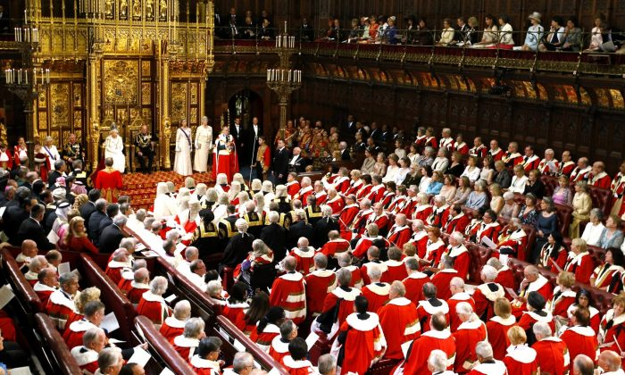 Queen Elizabeth II delivers a speech in the House of Lords in the Palace of Westminster during the opening of Parliament in London on May 27, 2015. (Alastair Grant/WPA Pool/Getty Images)