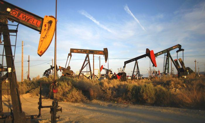 Pump jacks and wells are seen in an oil field on the Monterey Shale formation with gas and oil extraction using hydraulic fracturing, or fracking, on the verge of a boom, near McKittrick, Calif., on March 23, 2014. (David McNew/Getty Images)