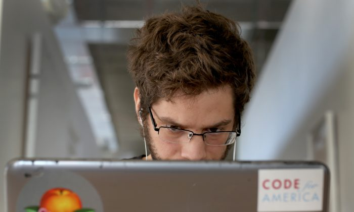 A person on laptop in Miami, Fla. in a file photo. (Joe Raedle/Getty Images)