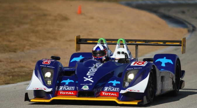 David Porter and Richard Bradley's #18 Pescarolo-Judd completed 80 laps in the 12 hours, making it the overall winner. (Chris Jasurek/Epoch Times)